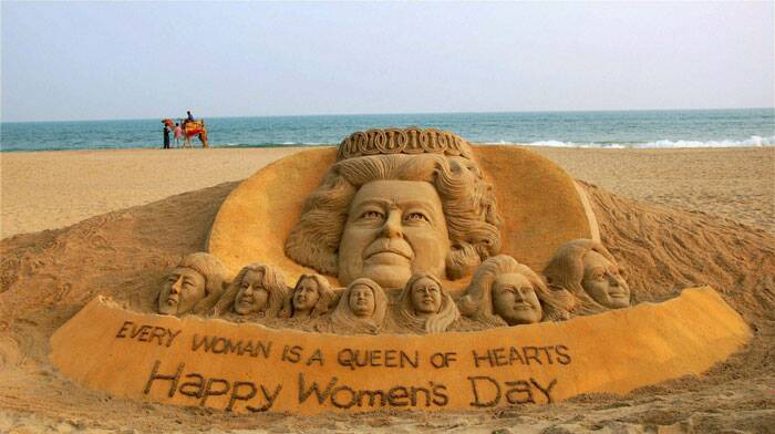 Sand artist Sudarsan Pattnaik creates a sand sculpture of queen Elizabeth II with the message 'Every Woman is a Queen of Hearts' at Puri beach of Odisha on the eve of Women's Day. (PTI)