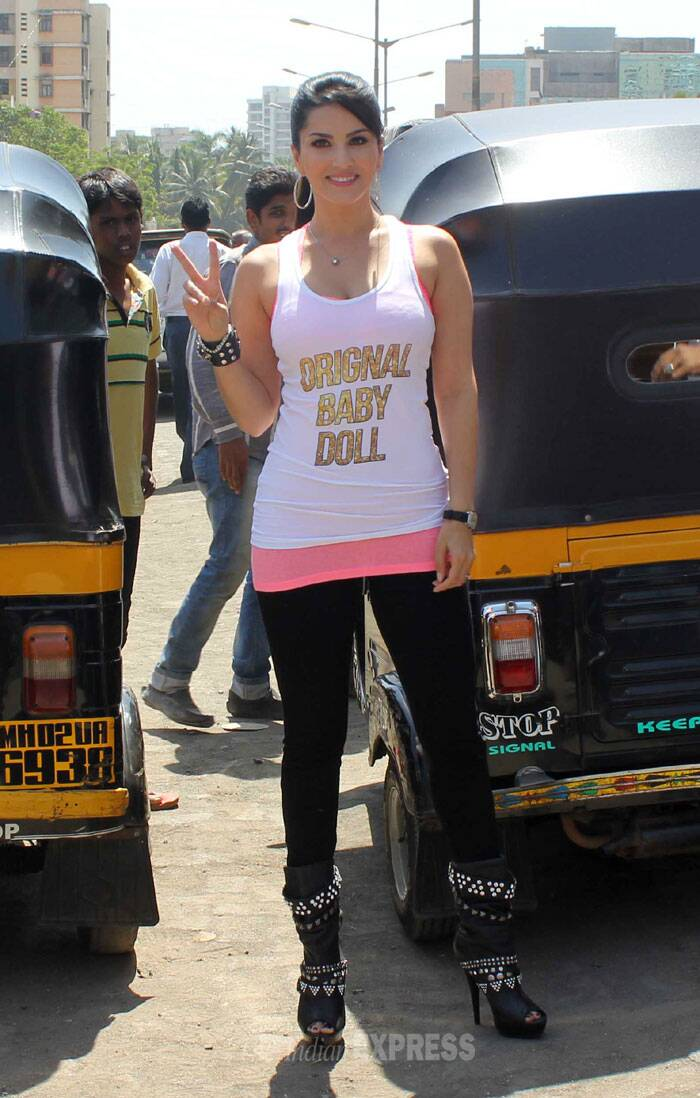 The actress showed off her figure in a white tank top with a neon coloured inner, black tights and black heels. (Photo: Varinder Chawla)