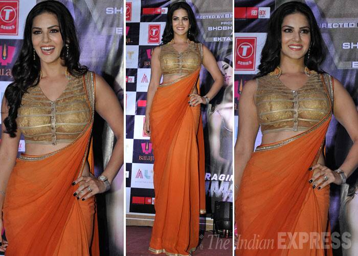 Sunny Leone oozed oomph in her orange Rohit Verma sari which she wore with a golden blouse. (Photo: Varinder Chawla)