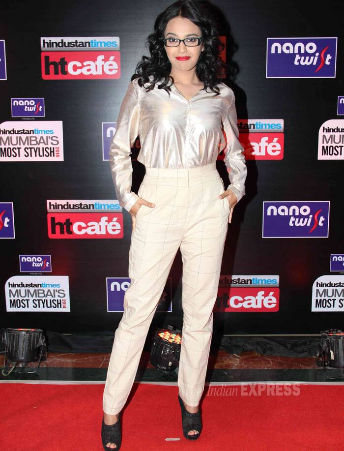 'Raanjhanaa' actress Sawara Bhaskar also managed a passing grade with the high waist checks crop pants and shimmering blouse. She opted for a geek look and added colour with red lips! (Photo: Varinder Chawla)
