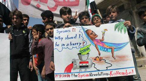 This photo provided by an anti-Bashar Assad activist group Edlib News Network (ENN) show anti-Syrian government protesters hold a placard resembling U.S. President Barack Obama during a demonstration, at Kafr Nabil town. (AP)