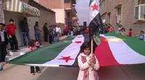 Demonstrators protesting against Syria's President Bashar al-Assad march through the streets after Friday prayers in Amude