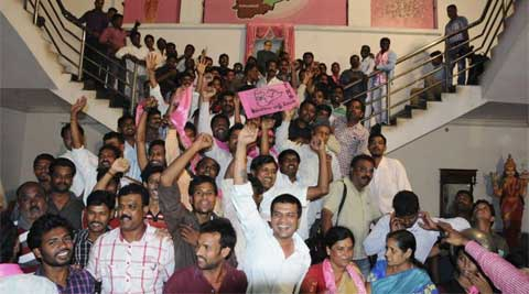 Telangana supporters celebrate after the announcement of the separate state of Telangana at their party headquarters in Hyderabad. (Reuters)