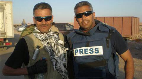 Mohamed Fahmy, a journalist for the Qatar-based Al-Jazeera English channel, right, poses for a photo with his friend journalist at an unknown location in Libya. The Egyptian-Canadian journalist is jailed and tried on terrorism-related charges.