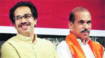 Manohar Joshi with Uddhav Thackeray.	(Express File)
