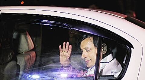 Shashi Tharoor waves to the mediapersons as he enters the venue. Ravi Kanojia