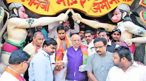 BJP's sitting MP from Lucknow Lalji Tondon and party president Rajnath Singh's Son Pankaj Singh campaign in Aminabad area of Lucknow, Tuesday.(IE photo: Vishal Srivastav)