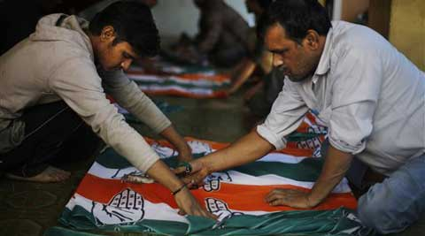 Indian workers prepare ruling Congress party election campaign materials at a workshop in New Delhi, India, Saturday, March 15, 2014.
