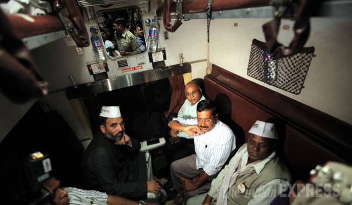 Aam Aadmi Party chief Arvind Kejriwal sits in the train before leaving for Varanasi for his rally at New Delhi railway station on Monday. (IE Photo: Ravi Kanojia)