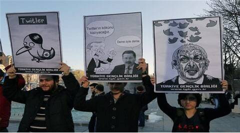 Members of the Turkish Youth Union hold cartoons depicting Turkey's Prime Minister Recep Tayyip Erdogan during a protest against a ban on Twitter, in Ankara. (AP)
