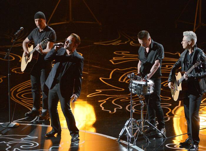 The Edge, from left, Bono, Larry Mullen, Jr. and Adam Clayton of U2 perform on stage during the Oscars at the Dolby Theatre in Los Angeles. (AP)