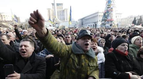 "crowd  chanting ""Rossiya! Rossiya!"" and waving the Russian tricolour. (Reuters)"