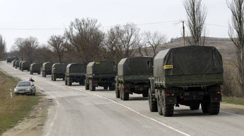 A convoy of military vehicles bearing no license plates travels on the road from Feodosia to Simferopol in the Crimea, Ukraine. (AP)