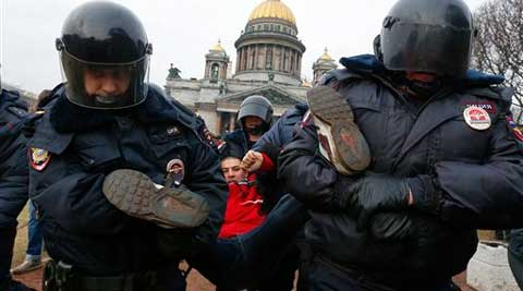 Police detain a protester demonstrating against the Russian military's actions in Crimea. (AP)