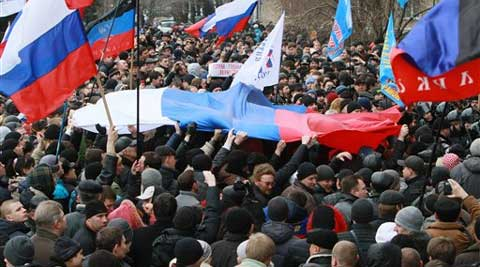 Pro-Russian activists hold Russian flags during a rally in the center of Donetsk, Ukraine. (AP)