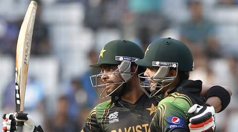 Pakistan's Umar Akmal celebrates after scoring a half century as teammate Kamran Akmal (R) congratulates him during their ICC Twenty20 World Cup match against Australia. (Reuters)