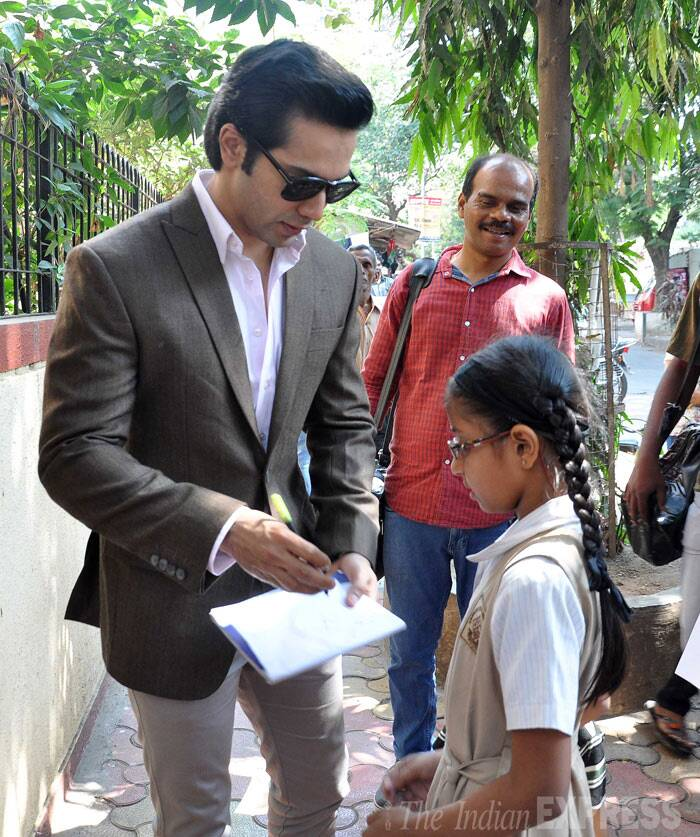 Another young girl wants 'Student Of The Year' actor's autograph.  (Photo: Varinder Chawla)