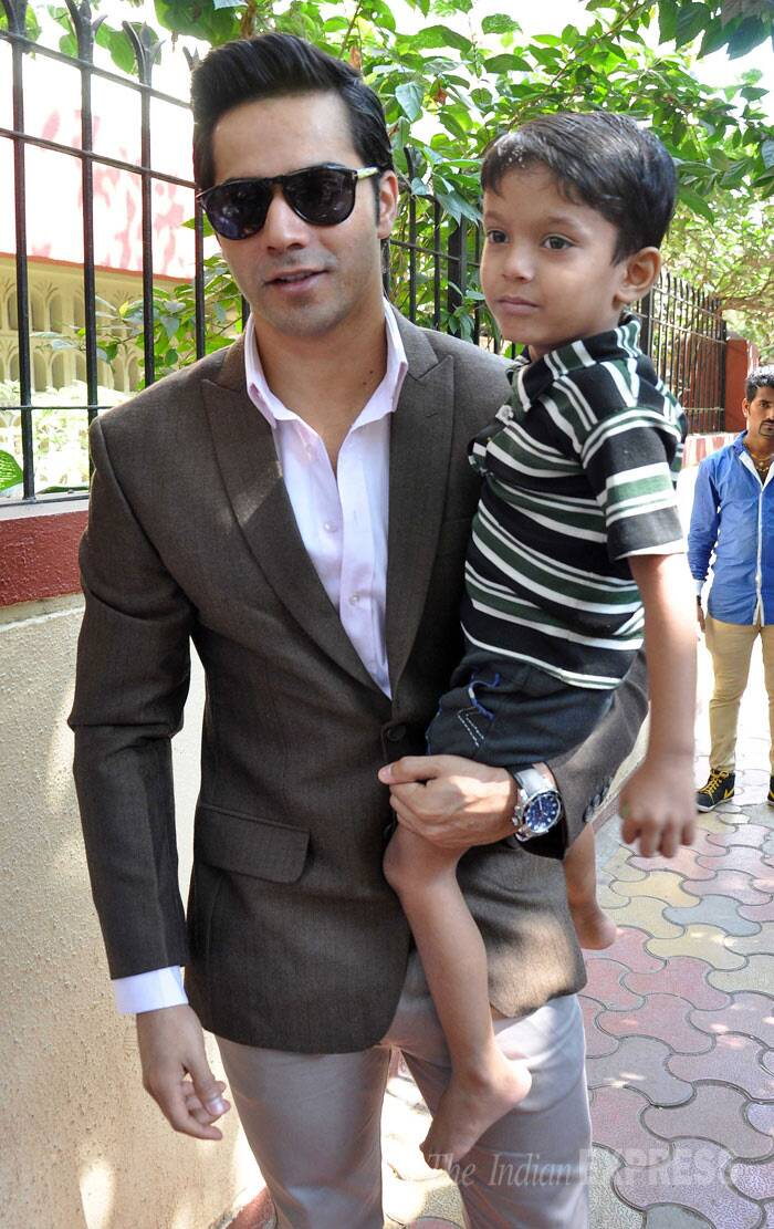 Awww! Varun holds his fan in his lap. (Photo: Varinder Chawla)