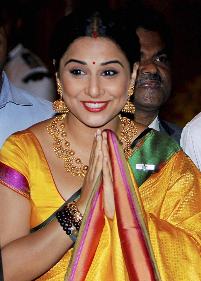 Vidya Balan looked lovely in a bright yellow sari with stunning gold jewellery. (PTI)