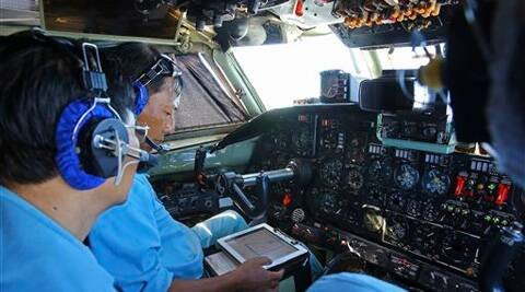 Cabin crews of Vietnam Air Force are seen onboard a flying AN-26 Soviet made aircraft during a search operation for the missing Malaysia Airlines flight MH370 plane. (AP)