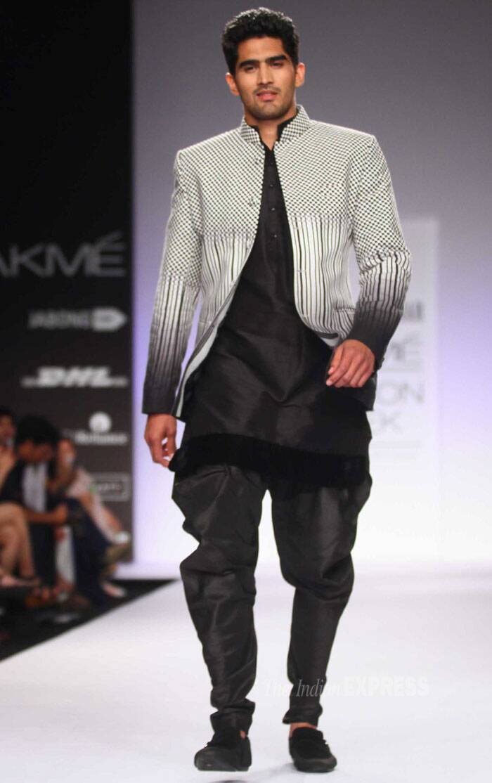 Meanwhile, boxer Vijender Singh walked the ramp to showcase designer Archana Kocchar's Paris AmourCollection at the Lakme Fashion Week 2014. (IE Photo: Amit Chakravarty)