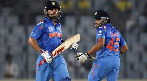 Chasing a modest total, Virat Kohli (L) and Rohit Sharma (R) hit fluent fifties (Reuters)