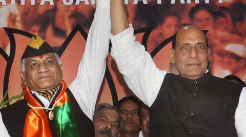 BJP chief Rajnath Singh Saturday inducted former Army Chief Gen V K Singh into the party. (PTI Photo)