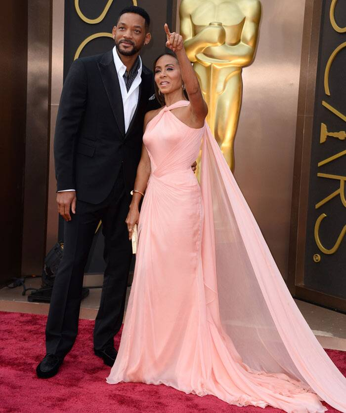 Hollywood couple Will Smith and Jada Pinkett arrived hand-in-hand. Jada was beautiful in a pink Versace gown with Cartier jewels and Ferragamo shoes, while Will wore Berluti. (AP)