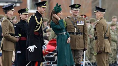 Kate, The Duchess of Cambridge and Prince William smile during a visit to the 1st Battalion Irish Guards at the St. Patrick's Day Parade on Monday. (AP)