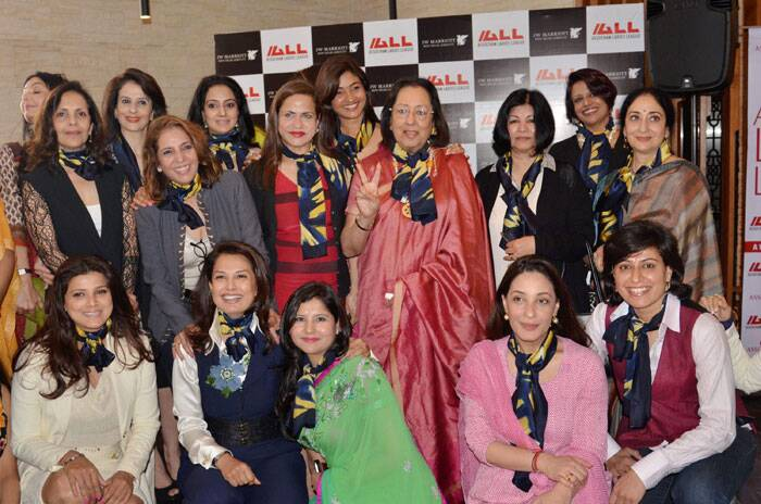 Harbeen Arora, Global Chairperson, ASSOCHAM Ladies League (ALL) and BJP member Najma Heptulla along with other noted women personalities at the launch of 'Women Solidarity Scarf' on the eve of International Women's Day in New Delhi. (PTI)
