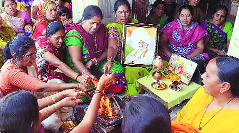 Women BJP workers perform a puja for Narendra Modi's victory in the upcoming Lok Sabha polls. (express)