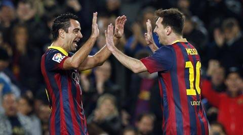 Xavi (left )has made more than 700 appearances for the Catalan club (File)