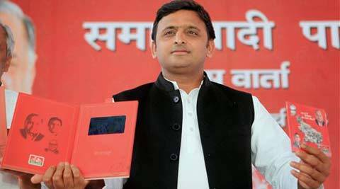 SP leader and Uttar Pradesh Chief Minister Akhilesh Yadav releasing materials for the party's Lok Sabha election campaign in Lucknow on Monday. (PTI Photo)