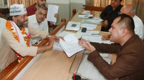 AAP candidate Yogendra Yadav filing his nomination papers in Gurgaon on Thursday. (PTI Photo)