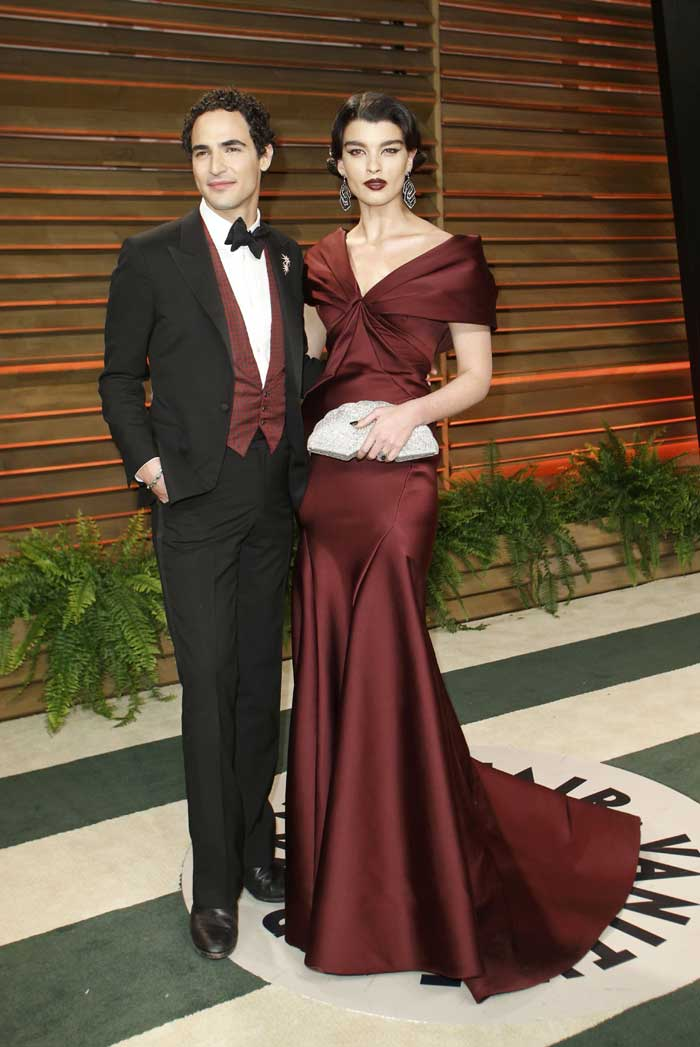 Designer Zac Posen and Crystal Renn look sharp as they pose for the shutterbugs. (Reuters)