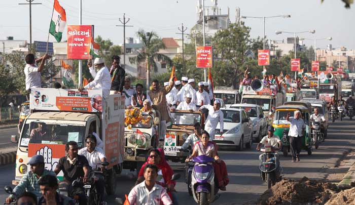 Congress candidate Madhusudan Mistry's election campaign roadshow passes through the city on Friday. (Express Photo By Bhupendra Rana)