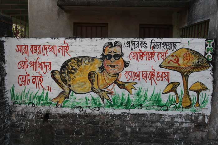 War of Words on the wall between TMC and BJP at Sreerampore in Hoogly on Lok Sabha election 2014 campaign. Bappi Lahiri is the BJP  and Kalyan Bandyopadhyaya is the TMC candidate. (Express photo by Subham Dutta)