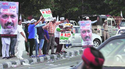 AAP workers on Ferozepur road in Ludhiana on Monday.