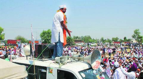 AAP candidate from Sangrur Bhagwant Mann addresses a gathering in Narangwal on Wednesday. Gurmeet Singh