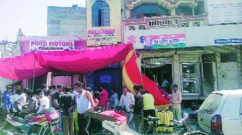 Food being distributed outside J P Agarwal's campaign office in Babbarpur on Tuesday. Express