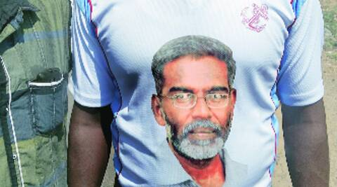 A supporter of AAP candidate Udayakumar wearing his face on his t-shirt.