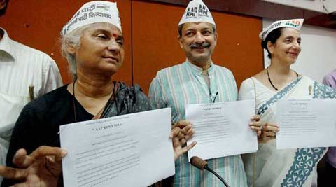AAP candidates Mayank Gandhi ,Medha Patkar and Meera Sanyal releasing the party manifesto during a press conference in Mumbai. (PTI Photo)