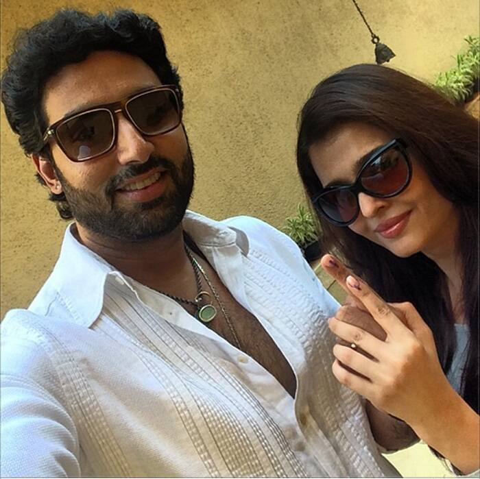 Abhishek Bachchan, posted a selfie of himself and Aishwarya showing their ink-stained finger and urging others to vote.