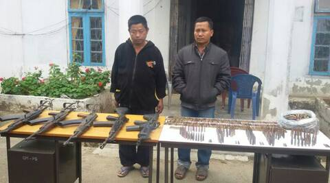 The seized arms and ammunition with V Laithanga and Zamang, who were arrested in connection with the case.