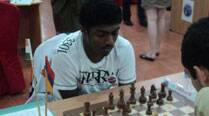 Adhiban recovers, stays in lead