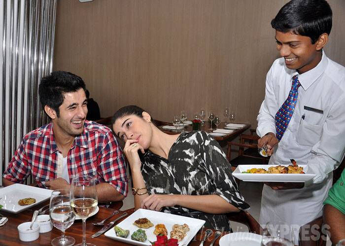 Wonder what has Aditya in splits, while Izabelle takes a time-out from the food. (Photo: Varinder Chawla)