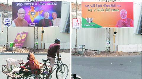 As poll fever intensifies, the BJP has recently replaced a giant hoarding of L K Advani with Narendra Modi's in Parimal Garden area of Ahmedabad. (Photo: Javed Raja)