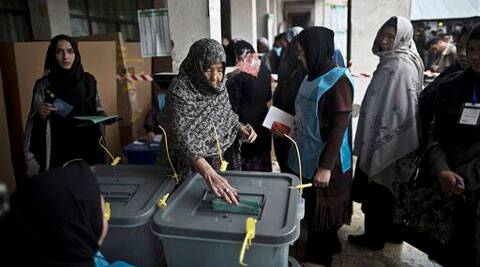 An elderly Afghan woman cats her ballot at a polling station in Kabul, Afghanistan, Saturday, April 5, 2014. Afghan voters lined up for blocks at polling stations nationwide on Saturday, defying a threat of violence by the Taliban to cast ballots in what promises to be the nation's first democratic transfer of power. (AP)