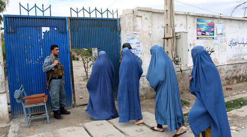 Afghan women enter a poling station to vote in Jalalabad, east of Kabul, Afghanistan. (AP)