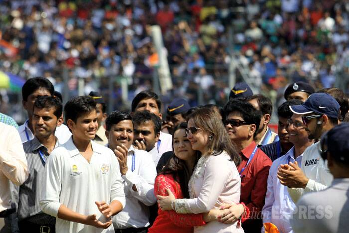 The little master, not known to express his emotions on the cricket field, spoke at length and thanked all those who helped him throughout his career, expressing his happiness over serving the country for so long. Seen here, Sachin Tendulkar's with his family. (IE Photo: Ravi Kanojia)